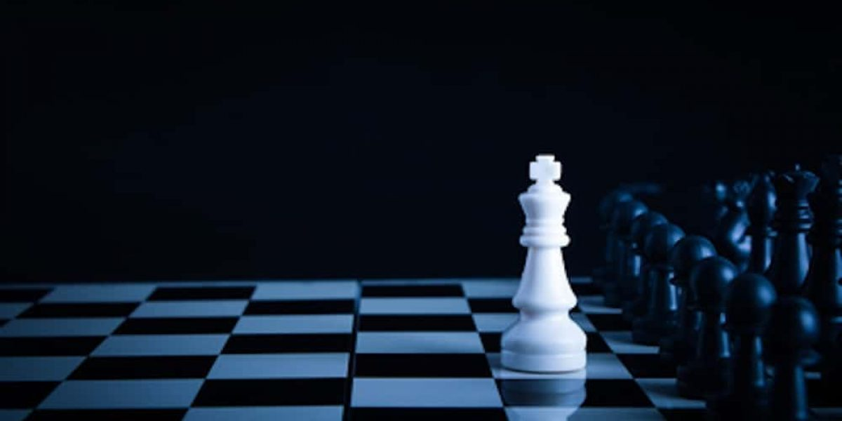 One chess is staying against full army of chess pieces.